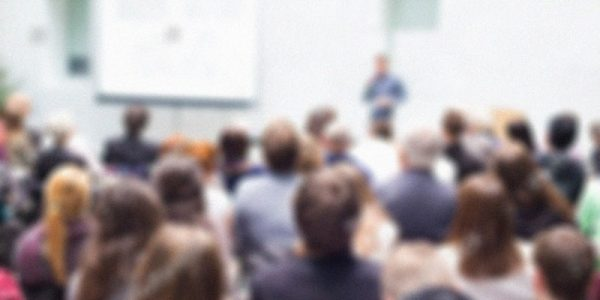 stock-photo-speaker-giving-a-talk-at-business-meeting-audience-in-the-conference-hall-business-and-261534164
